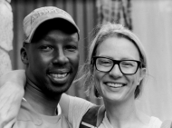 UC's Adrian Parr and a man from Nairobi, Africa, stand together smiling as they work on sustainability issues.