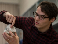 Researcher holds up geologic sample