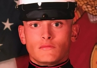 An extreme close-up of a man, a Marine in full dress uniform. It is University of Cincinnati alumnus Austin Cox.