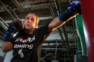 University of Cincinnati student and boxing champ Katie Harrington takes a stab at a boxing bag.