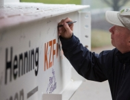 Dean signs final beam for new Lindner building