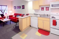 A bright room with red and cream accents -- a dorm room at the University of Cincinnati