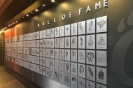 Photo of many, many plaques on a Hall of Fame wall.