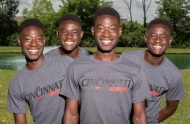 Two sets of identical African-American twin boys smile for the University of Cincinnati camera