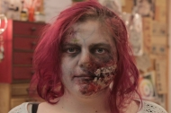 A student in ghoulish makeup for Halloween