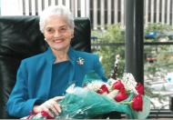 A beautiful, older white-haired woman, University of Cincinnati alumna and honoree Marian Spencer.