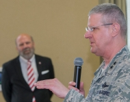 Man speaks to crowd during Cyber range kickoff event