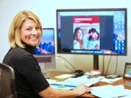 Janet Staderman at a desk