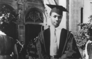 An old photograph of an African-American UC graduate in his cap and gown