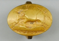 A bright shining gold emblem -- an artifact from a Greek warrior's tomb.