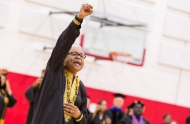 African-American and long-time director of the University of Cincinnati African American Resource Center Eric Abercrumbie raises his fist at the annual Tyehimba event.
