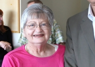 An elderly woman with gray hair and glasses -- looks younger than her 80 years.