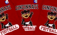 A couple of red sweatshirts with the University of Cincinnati logo and mascot, the Bearcat