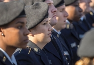 Female U.S. armed services veterans stand in a line during Veterans Day ceremonies