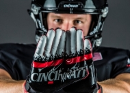 Cool photo of a University of Cincinnati football player in full gear holding up his gloved hands in front of his face -- with the word Cincinnati spelled out in the palms of the gloves.