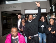 Man exits courthouse after being freed from prison