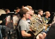The brass section of the University of Cincinnati musical ensemble in practice.