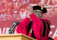 University of Cincinnati president Neville Pinto applauds the UC graduates at commencement.