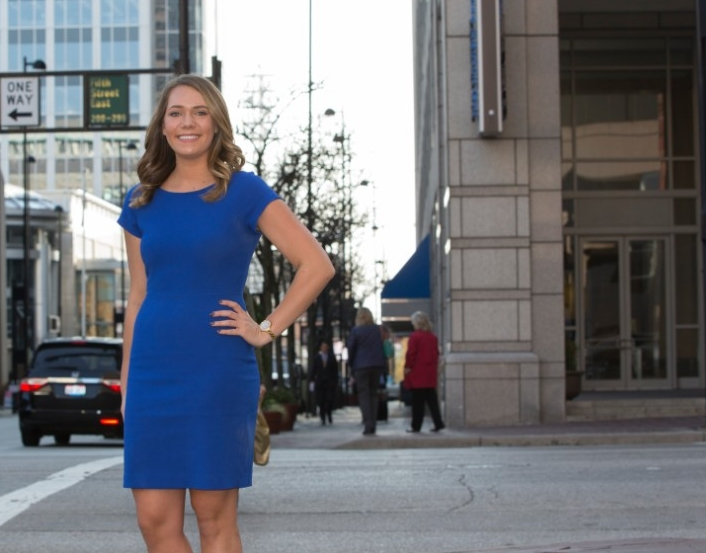 Emily Blueher stands outside of her employer's office on Fifth Street in downtown Cincinnati.