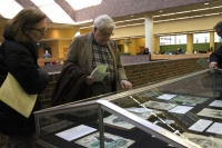 People look through glass case at books at the Cinti. Public Library.