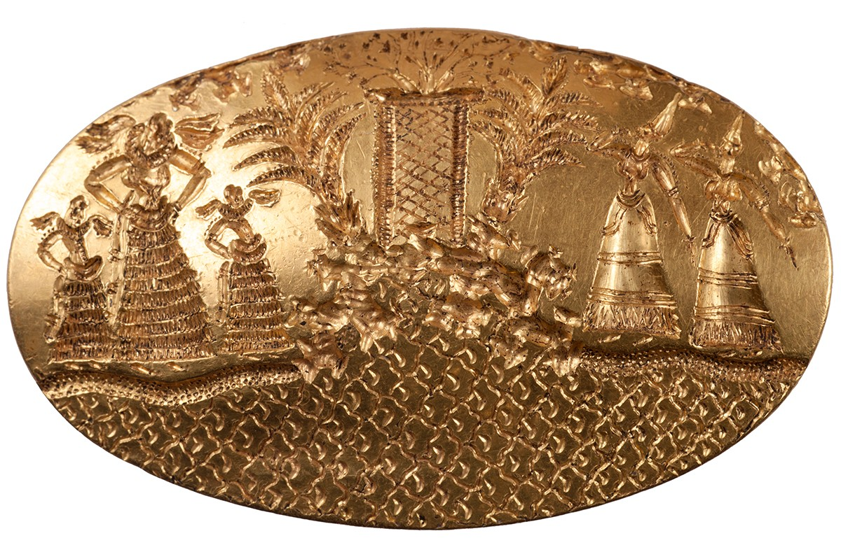 The excavation yielded the discovery of the second largest gold signet ring known in the Aegean world, which shows five elaborately dressed female figures gathered by a seaside shrine.