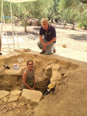 UC's Sharon Stocker, left, and Jack Davis, right, have worked in the Pylos region of Greece for 25 years. They led a team of 45 archaeologists and experts in various specialties as well as students during this summer's excavations. Stocker stands in the shaft tomb the team uncovered.