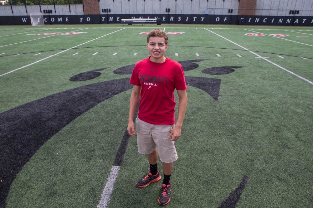 Mitch Stone, 18, stands on Sheakley Field before starting his first semester as a Bearcat this fall.