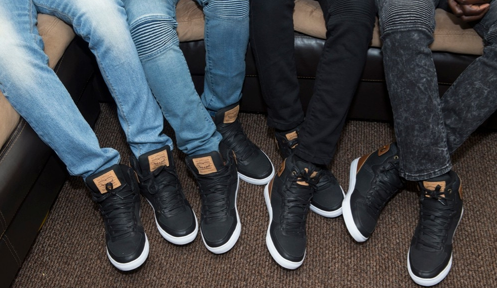 Close-up of all eight shoes on UC students and brothers Godfred, Alfred, Alvin and Kelvin Mantey. photo/Joseph Fuqua II/UC Creative Services