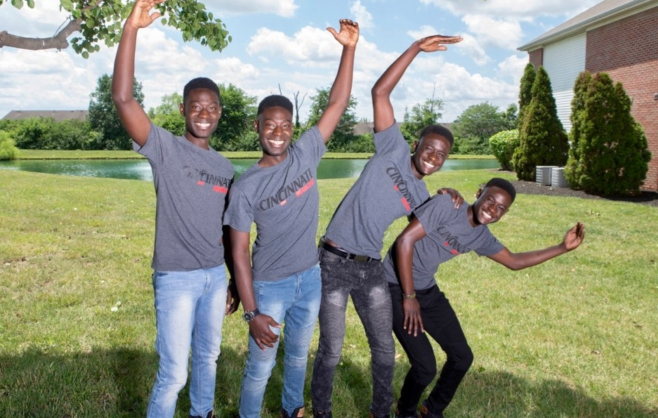 UC students and brothers Godfred, Alfred, Alvin and Kelvin Mantey stand with their arms in the infamous UC pose. photo/Joseph Fuqua II/UC creative Services