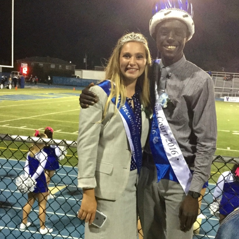 UC student Alvin Mantey as homecoming king standing with the homecoming queen at his former Hamilton High School.