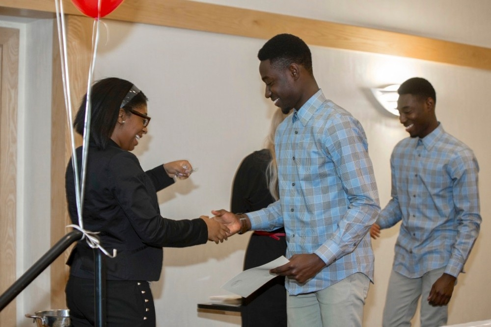 UC students Alfred and Godfred Mantey each receive Alpha Lambda Delta Honor Society awards at a UC ceremony.