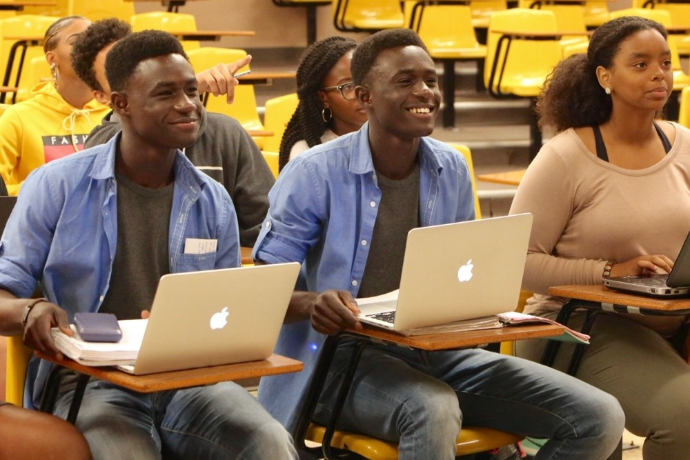 Incoming freshmen, Kelvin and Alvin Mantey sit in a UC chemistry class. photo/Melanie Schefft