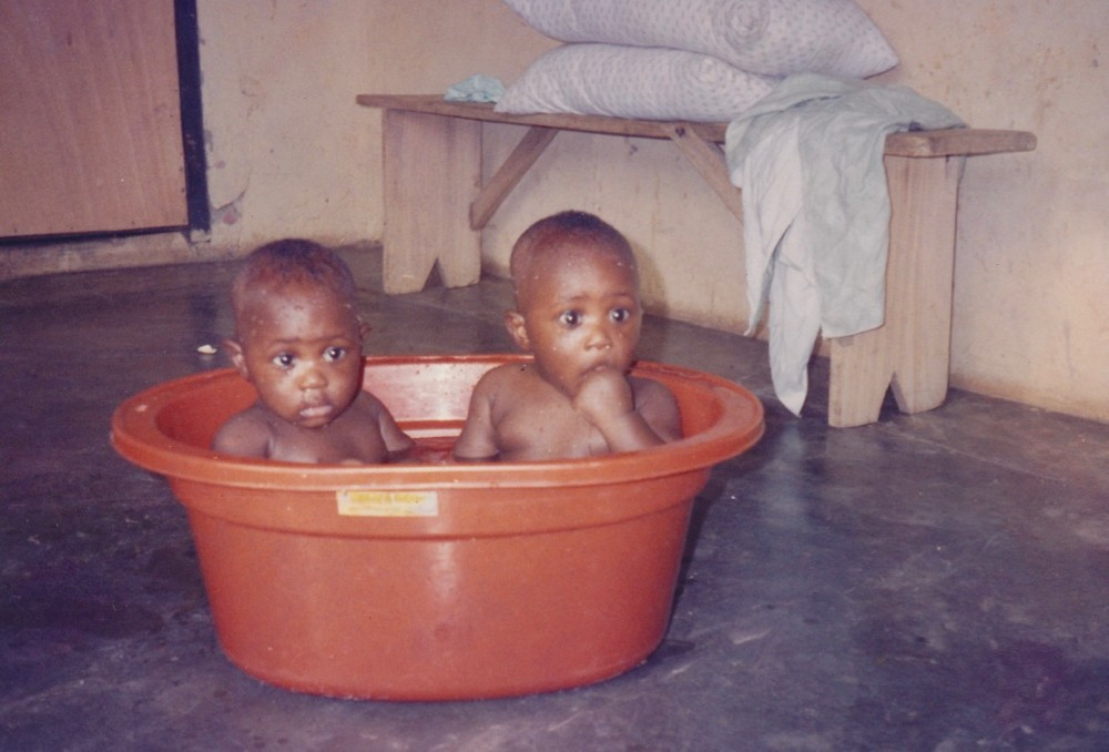 UC identical twins, Alvin and Kelvin Mantey sit in a bathtub as babies in their hometown in Ghana, Africa.