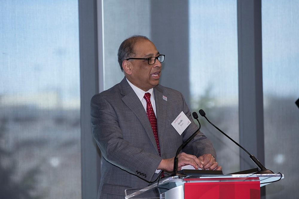 President Neville Pinto speaks at the Marian Spencer Hall dedication.