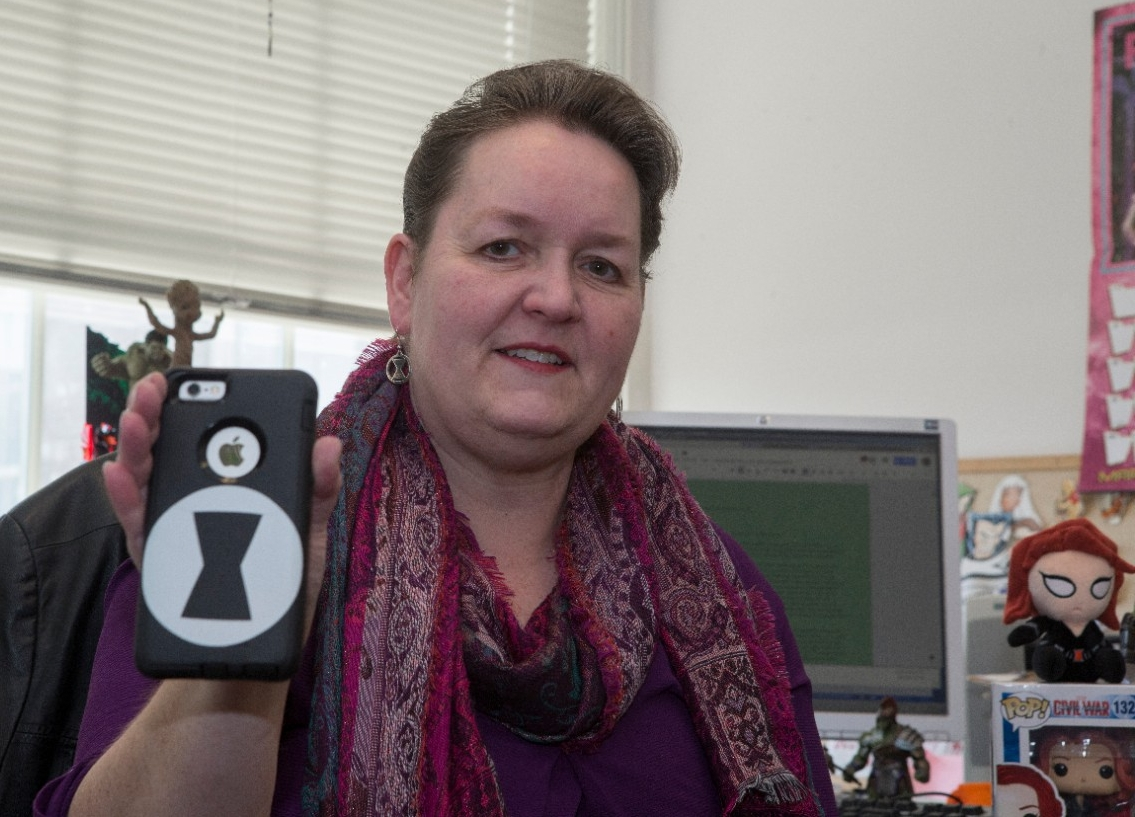 UC English professor Rebecca Borah holds up her Black Widow-themed iPhone case.