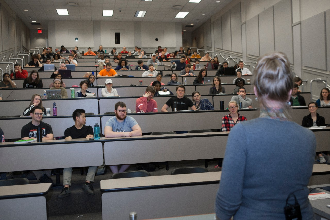 UC students in the medical botany class listen to Molly Wellmann's presentation.