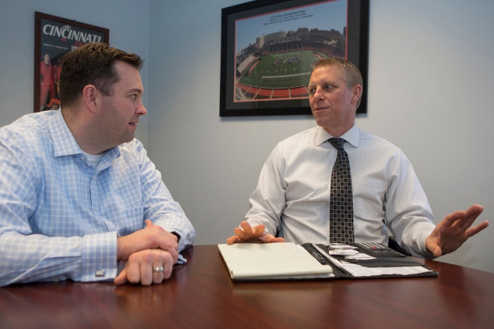 Luke Willman left sits with Joe Harrell during a Mentor Me UC mentoring session.