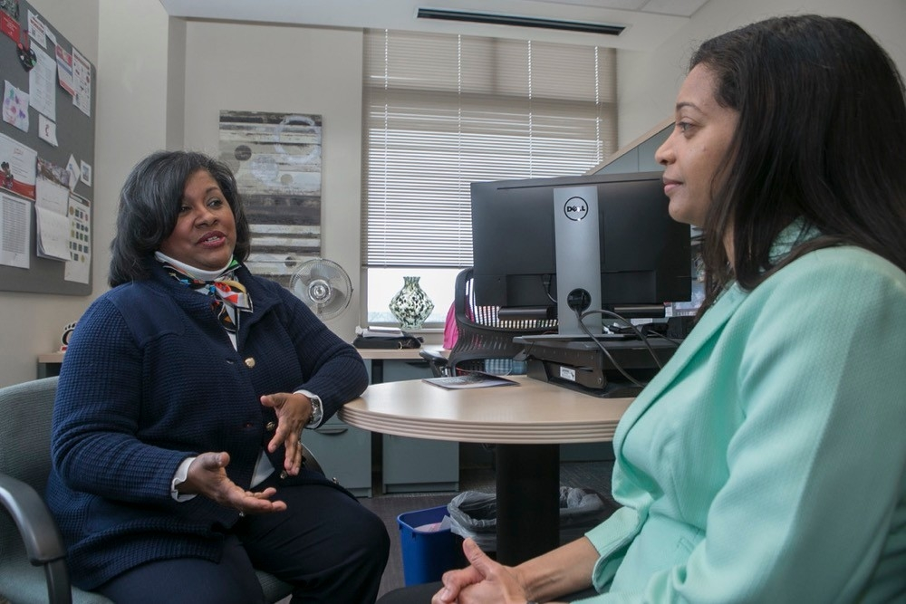 UC's Shelly Sherman left and Keisha James right sit together during their Mentor Me UC mentoring session.