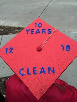 Cory Murphy's mortarboard proclaims 10 Years Clean