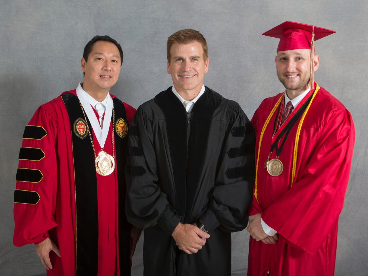 Murphy with UC President Santa Ono and commencement speaker Kirk Perry, Bus '90, HonDoc '15, president of brand solutions at Google.
