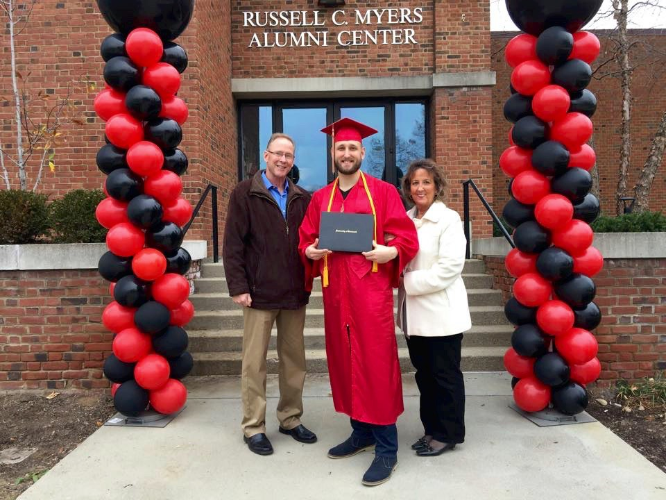 Murphy stands with his parents after commencement on UC's campus.