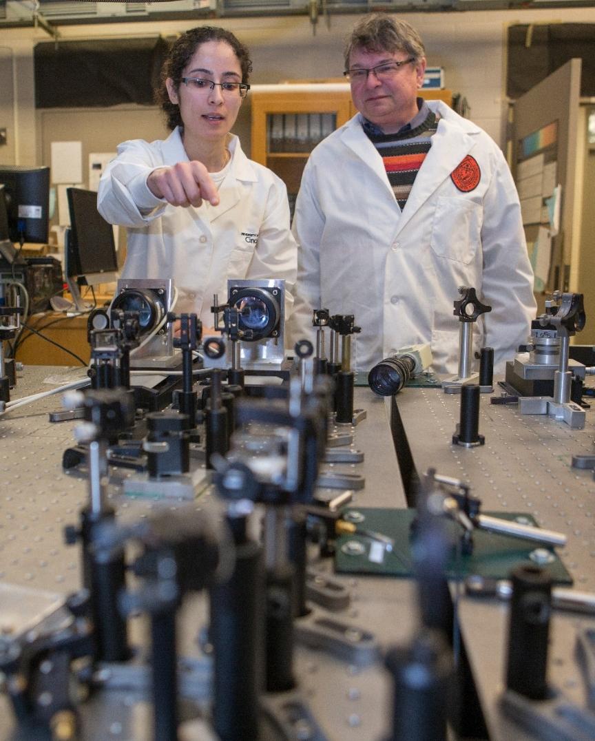 UC graduate student Fatemesadat Mohammadi demonstrates how she fires lasers at nanorod samples.