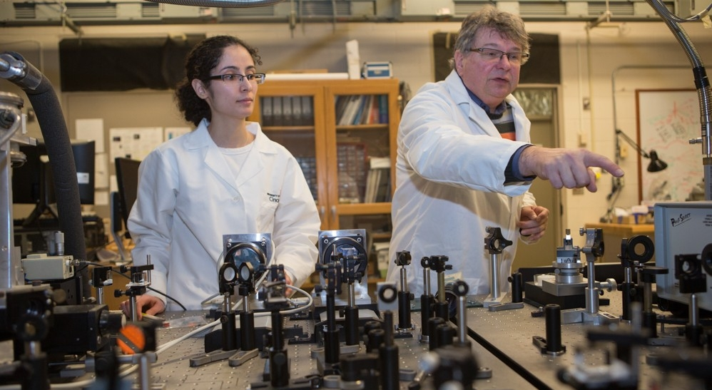 UC physics student Fatemesadat Mohammadi and Associate Professor Hans-Peter Wagner are studying nanowire in their lab at the University of Cincinnati.