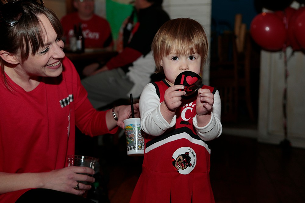 A young UC fan shows off her colors.