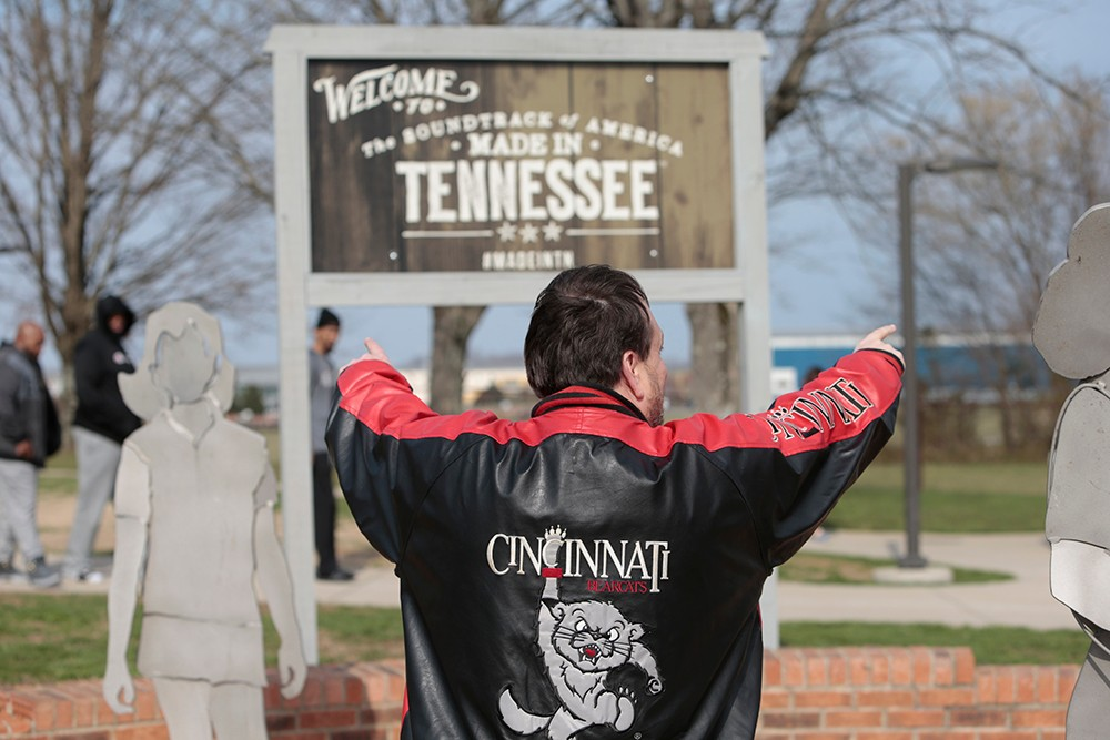 A UC fan shows off his colors at a rest stop in Tennessee.