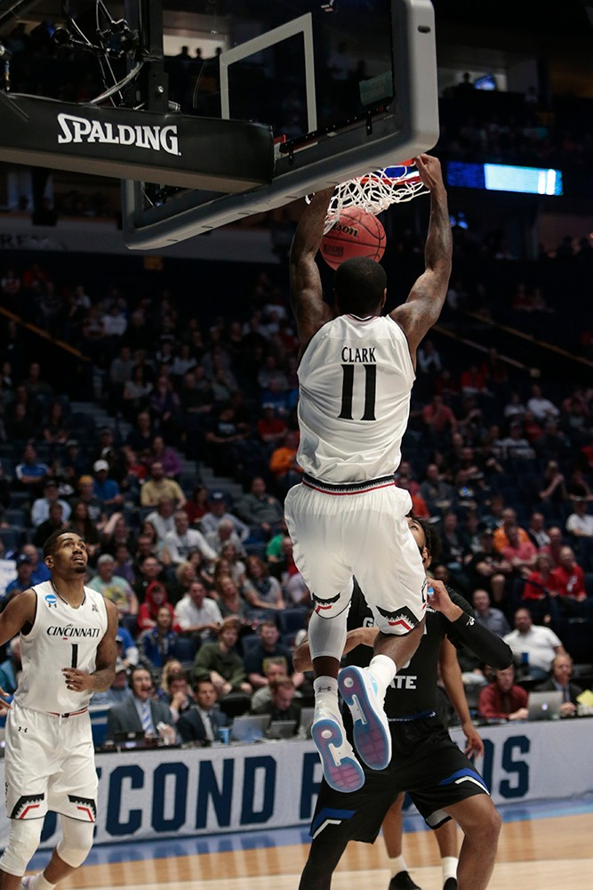Gary Clark slams down a dunk.