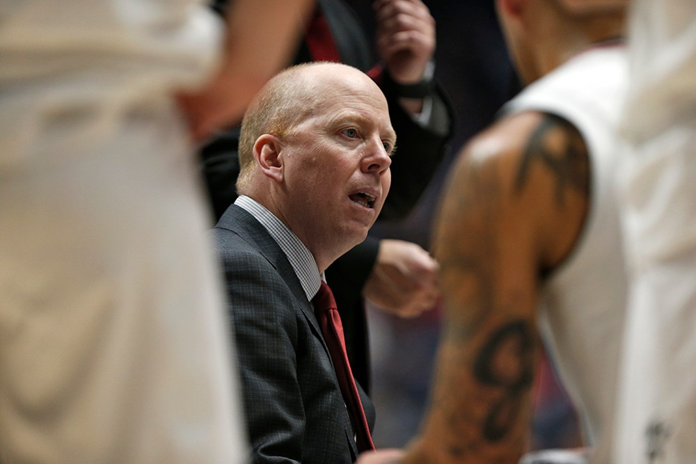 Coach Cronin talks to his players during a timeout.