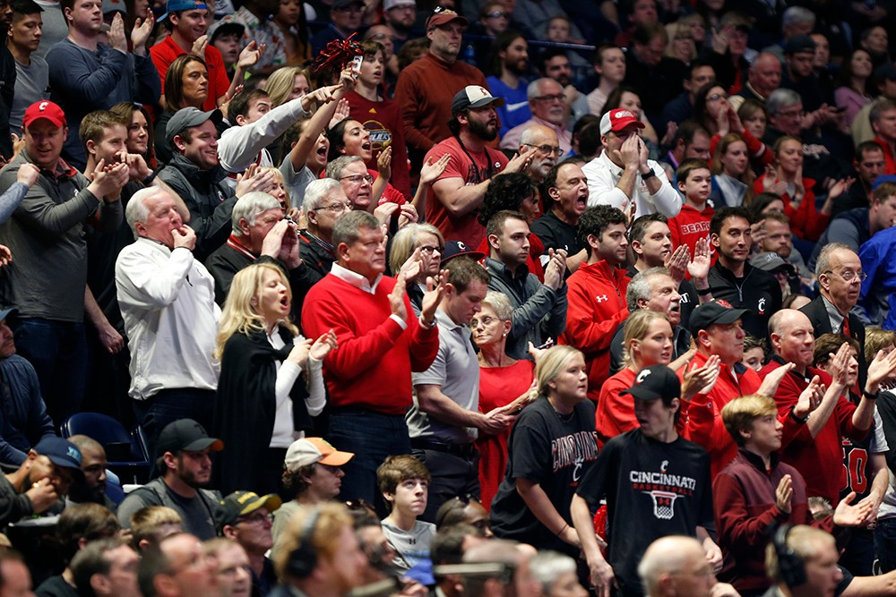 A crowd of UC fans cheering.