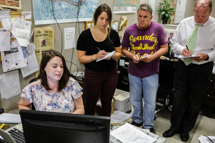 Elizabeth DePompei trains coworkers at the News and Tribune