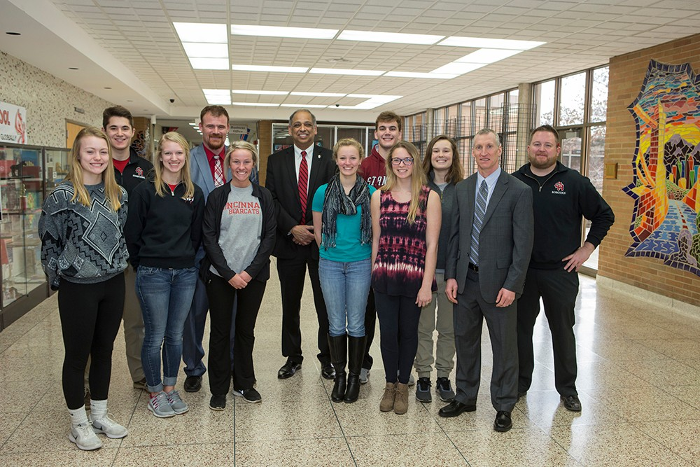 UC President Neville Pinto with high school students